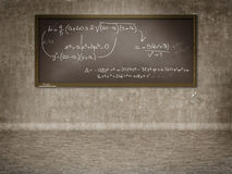 Equation on blackboard Stock Photos