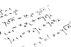 Equations. On a sheet of paper Royalty Free Stock Photo