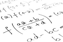 Equations. On a sheet of paper Royalty Free Stock Image
