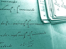 Equations. A background of equations on a notebook in turquoise tone royalty free stock image