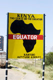 The Equator line road sign. Road sign marking the Equator near Nanyuki, Kenya. The Equator refers to the Earth's equator and is an imaginary line on the Earth's Stock Photo