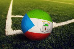 Equatorial Guinea ball on corner kick position, soccer field background. National football theme on green grass.  royalty free stock photography