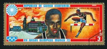 Hurdling and Odeonsplatz. EQUATORIAL GUINEA - CIRCA 1972: stamp printed by Equatorial Guinea, shows Hurdling and Odeonsplatz, circa 1972 Stock Photo