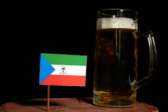 Equatorial Guinea flag with beer mug isolated on black Stock Photo