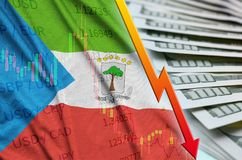 Equatorial Guinea flag and chart falling US dollar position with a fan of dollar bills. Concept of depreciation value of US dollar currency stock image