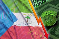 Equatorial Guinea flag and cryptocurrency falling trend with two bitcoins on dollar bills and binary code display. Concept of reduction Bitcoin in price and royalty free stock photos