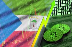 Equatorial Guinea flag and cryptocurrency growing trend with two bitcoins on dollar bills and binary code display. Concept of raising Bitcoin in price and high stock image