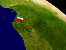 Equatorial Guinea with flag on Earth Stock Images