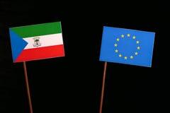 Equatorial Guinea flag with European Union EU flag isolated on black. Background Royalty Free Stock Photo