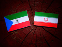 Equatorial Guinea flag with Iranian flag on a tree stump isolate. D Stock Photography