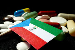 Equatorial Guinea flag with lot of medical pills isolated on bla Royalty Free Stock Photography