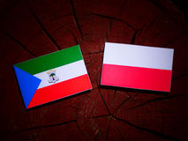 Equatorial Guinea flag with Polish flag on a tree stump isolated. Equatorial Guinea flag with Polish flag on a tree stump royalty free illustration