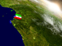 Equatorial Guinea with flag in rising sun Stock Photography