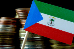 Equatorial Guinea flag waving with stack of money coins Royalty Free Stock Photo