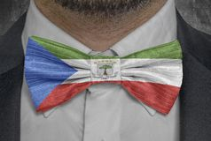 Equatorial Guinea national flag on bowtie business man suit. Close stock photography