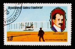 Equatorial Guinea postage stamp shows Wright Brothers Flyer 1903 and O. Wright portrait, circa 1979 Stock Image