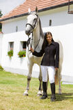 Equestrian con il cavallo fotografie stock