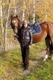 Equestrian con su caballo Foto de archivo libre de regalías