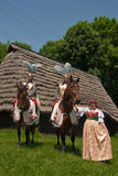 Equestrian Crusaders with folklore dancer Royalty Free Stock Image