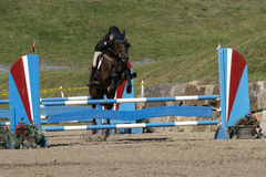 Equestrian event - jumper. Picture of rider and horse making a jump  during competition at the bromont concours June 12, 2016 Stock Photo