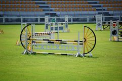 Equestrian Field. View of an equestrian field, focus on jumping fence Royalty Free Stock Photography