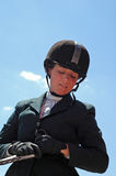 Equestrian Girl. Teenage girl on horse against blue sky, horse not seen Stock Photography
