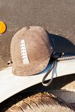 Equestrian helmet forgotten on horse trailer`s fender. Outdoors Stock Photos