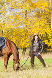 Equestrian with her horse Stock Photo