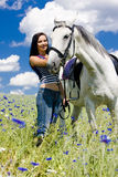 Equestrian with a horse. On meadow Stock Image