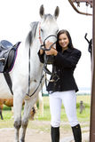 Equestrian with horse. Young woman equestrian with horse Stock Photo