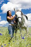 Equestrian with a horse Royalty Free Stock Image