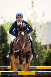Equestrian Horse Rider Jumping.Picture showing a competitor performing in show jumping competition. Horse Show Circuit 2015 EQUESTRIA. Equestrian Show Jumping Stock Photography