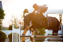 Equestrian Horse Rider Jumping.Picture showing a competitor performing in show jumping competition Stock Photography
