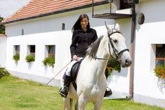 Equestrian on horseback. Young woman equestrian on horseback Royalty Free Stock Photo