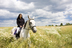 Equestrian on horseback. Young woman equestrian on horseback Royalty Free Stock Image