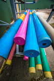 Equestrian jumping poles in various colors. Stack of equestrian jumping poles in various colors Stock Photos