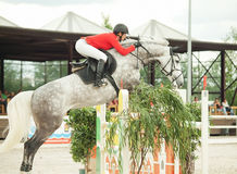 Equestrian jumping sport. SAINT-PETERSBURG-JULY  17: Rider in Jumping show, stage of the International show jumping event CSI3*-W/CSIYH1*, on July 17, 2011 in Stock Photo