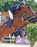 Equestrian jumping sport. SAINT-PETERSBURG-JULY 17: Rider Tiit Kivisild on Torrero in Jumping show, stage of the International show jumping event CSI3*-W/CSIYH1 Stock Images