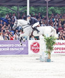Equestrian jumping sport. SAINT-PETERSBURG-JULY 17: Rider Matas Petraitis on Cattio in Jumping show, stage of the International show jumping event CSI3*-W/CSIYH1 Royalty Free Stock Photo