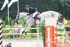 Equestrian jumping sport. SAINT-PETERSBURG-JULY 17: Rider Matas Petraitis on Cattio in Jumping show, stage of the International show jumping event CSI3*-W/CSIYH1 Stock Images