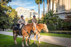 Equestrian Police guards stand by State Capitol Building Stock Image