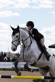 Equestrian Show Jumping. A rider takes her horse over a set of hurdles during an  annual show jumping event at Princeton New Jersey Stock Images