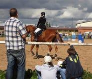 Equestrian sport (конный спорт). Equestrian sport -  tournament on jumping (конный спорт), children's schools Stock Images