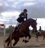 Equestrian sport (конный спорт). Equestrian sport -  tournament on jumping (конный спорт), children's schools Royalty Free Stock Photo