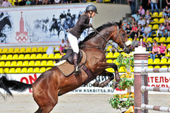 Equestrian sport. Female show jump rider. Royalty Free Stock Image