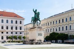 Equestrian statue of Elector Maximilian I. MUNICH, GERMANY - MAY 22, 2018: tourist near Equestrian statue of Elector Maximilian I at Wittelsbacherplatz. Munich stock photos