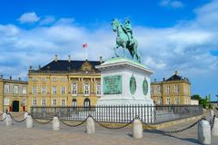 Equestrian statue of Frederik V by Amalienborg courtyard architectural building, Copenhagen, Denmark stock photo