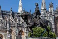 Statue of Nuno Alvares Pereira in front of the Batalha Monastery. Equestrian statue of General Nuno Alvares Pereira commemorates his 1385 victory over the Royalty Free Stock Photos
