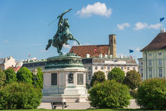 Equestrian statue at Heldenplatz with Minoritenkirche Church in Stock Images