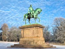 Equestrian statue of Karl XIV Johan in Oslo in winter, Norway. The statue was erected in 1875 in front of Royal Palace. The motto on pedestal reads: The love royalty free stock image